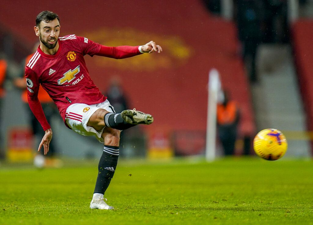Manchester United's Bruno Fernandes kicks the ball during the English Premier League soccer match between Manchester United and Sheffield United at Old Trafford, Manchester, England, Wednesday, Jan. 27, 2021. (AP Photo/Tim Keeton,Pool)