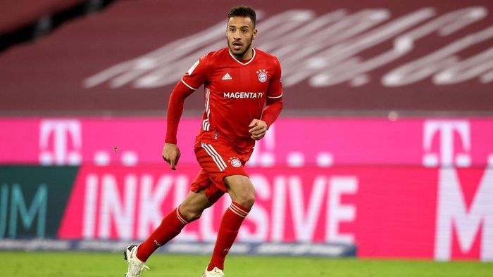 MUNICH, GERMANY - DECEMBER 16: Corentin Tolisso of FC Bayern München runs with the ball during the Bundesliga match between FC Bayern Muenchen and VfL Wolfsburg at Allianz Arena on December 16, 2020 in Munich, Germany. (Photo by Alexander Hassenstein/Getty Images)