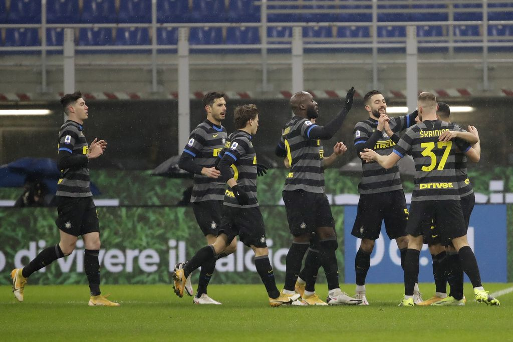 Inter Milan players celebrate a goal against Benevento during a Serie A soccer match between Inter Milan and Benevento at the San Siro stadium in Milan, Italy, Saturday, Jan. 30, 2021. (AP Photo/Luca Bruno)