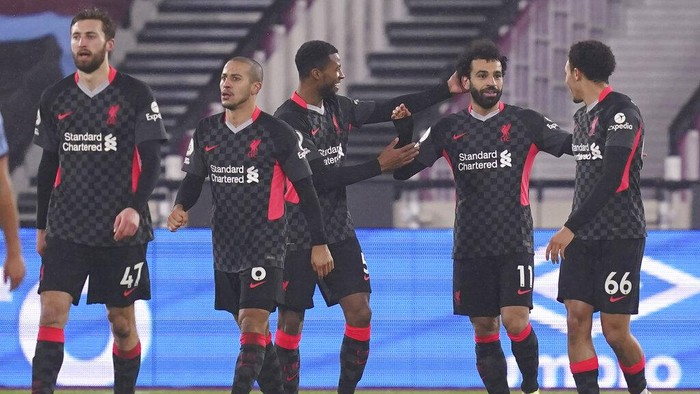 Liverpools Mohamed Salah, second right, celebrates after scoring his sides opening goal during the English Premier League match between West Ham and Liverpool at the the London Stadium in London, Sunday, Jan. 31, 2021. (John Walton/Pool via AP)