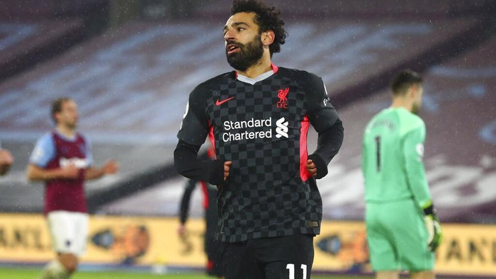 Liverpools Mohamed Salah celebrates after scoring his sides second goal during the English Premier League match between West Ham and Liverpool at the the London Stadium in London, Sunday, Jan. 31, 2021. (Clive Rose/Pool via AP)