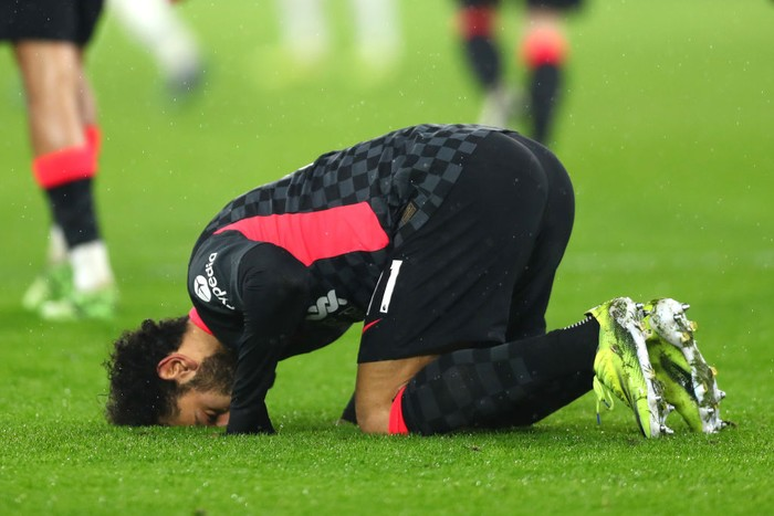 LONDON, ENGLAND - JANUARY 31: Mohamed Salah of Liverpool celebrates after scoring their sides second goal during the Premier League match between West Ham United and Liverpool at London Stadium on January 31, 2021 in London, England. Sporting stadiums around the UK remain under strict restrictions due to the Coronavirus Pandemic as Government social distancing laws prohibit fans inside venues resulting in games being played behind closed doors. (Photo by Clive Rose/Getty Images)