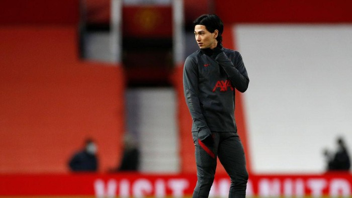 MANCHESTER, ENGLAND - JANUARY 24: Takumi Minamino of Liverpool warms up ahead of The Emirates FA Cup Fourth Round match between Manchester United and Liverpool at Old Trafford on January 24, 2021 in Manchester, England. Sporting stadiums around the UK remain under strict restrictions due to the Coronavirus Pandemic as Government social distancing laws prohibit fans inside venues resulting in games being played behind closed doors. (Photo by Phil Noble - Pool/Getty Images)