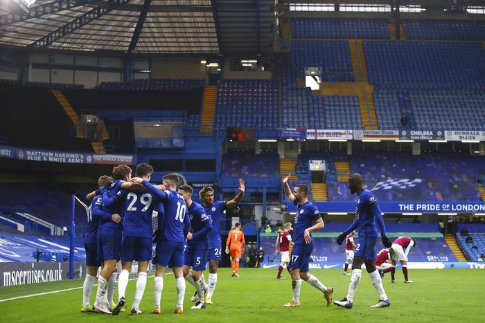 Chelsea players celebrate after Marcos Alonso scored his sides second goal during the English Premier League soccer match between Chelsea and Burnley at Stamford Bridge Stadium in London, England, Sunday, Jan. 31, 2021.(Julian Finney/Pool Via AP)
