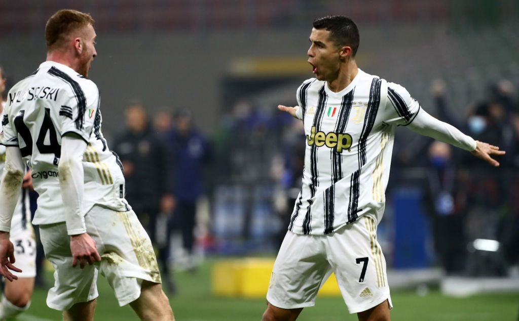 MILAN, ITALY - FEBRUARY 02: Cristiano Ronaldo of Juventus celebrates with team mate Dejan Kulusevski after scoring their side's second goal during the Coppa Italia semi-final match between FC Internazionale and Juventus at Stadio Giuseppe Meazza on February 02, 2021 in Milan, Italy. Sporting stadiums around Italy remain under strict restrictions due to the Coronavirus Pandemic as Government social distancing laws prohibit fans inside venues resulting in games being played behind closed doors. (Photo by Marco Luzzani/Getty Images)