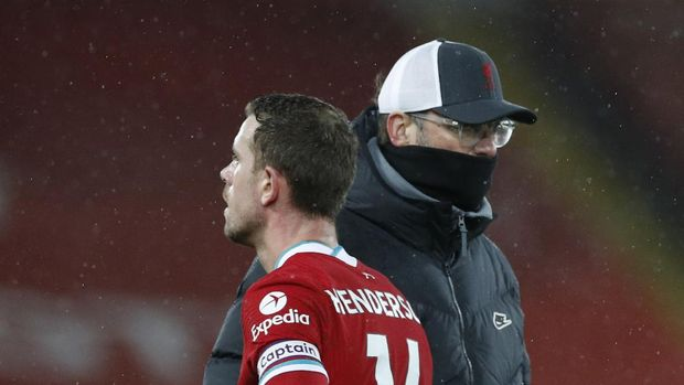 Liverpool's manager Jurgen Klopp cheers with Jordan Henderson at the end of the English Premier League soccer match between Liverpool and Brighton at Anfield stadium, in Liverpool, England, Wednesday, Feb. 3, 2021. (Phil Noble/Pool via AP)