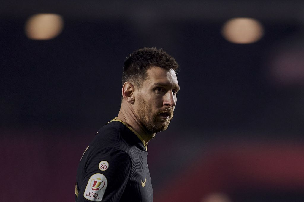 Barcelona's Lionel Messi looks on during a Spanish Copa del Rey quarter finals soccer match between Granada and FC Barcelona at the Los Carmenes stadium in Granada, Spain, Wednesday, Feb. 3, 2021. (AP Photo)