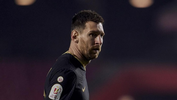 Barcelonas Lionel Messi looks on during a Spanish Copa del Rey quarter finals soccer match between Granada and FC Barcelona at the Los Carmenes stadium in Granada, Spain, Wednesday, Feb. 3, 2021. (AP Photo)