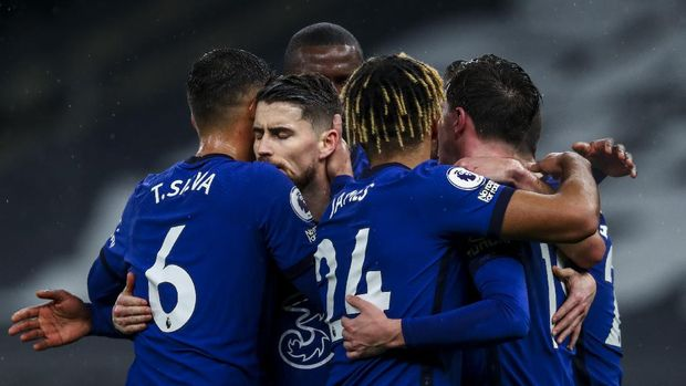 Chelsea players celebrate after scoring the opening goal during the English Premier League soccer match between Tottenham and Chelsea at the Tottenham Hotspur Stadium in London, England, Thursday, Feb. 4, 2021. (Clive Rose/Pool via AP)