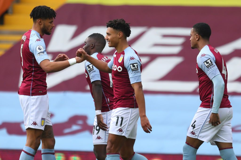 BIRMINGHAM, ENGLAND - FEBRUARY 06: Ollie Watkins of Aston Villa celebrates with team mate Tyrone Mings after scoring their side's first goal during the Premier League match between Aston Villa and Arsenal at Villa Park on February 06, 2021 in Birmingham, England. Sporting stadiums around the UK remain under strict restrictions due to the Coronavirus Pandemic as Government social distancing laws prohibit fans inside venues resulting in games being played behind closed doors. (Photo by Catherine Ivill/Getty Images)