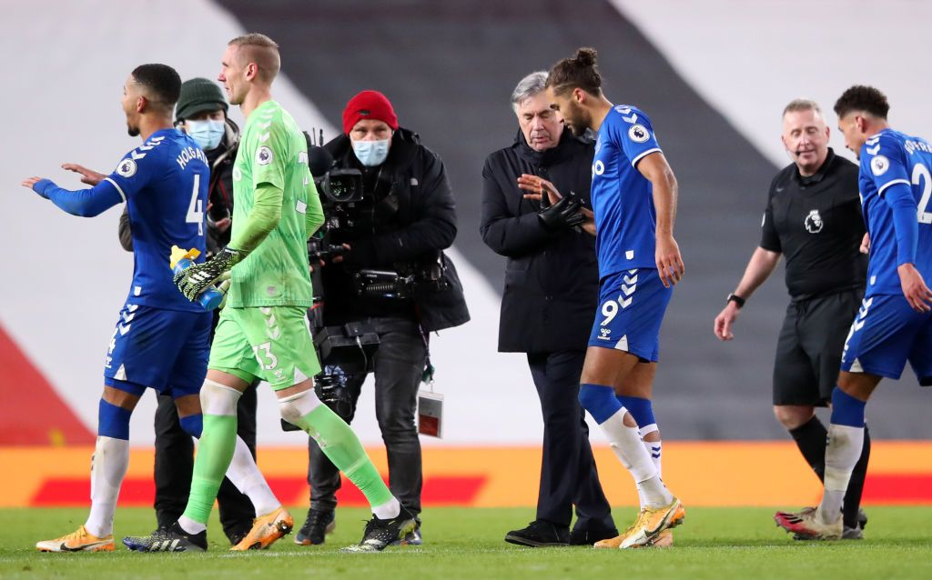 MANCHESTER, ENGLAND - FEBRUARY 06: Carlo Ancelotti, Manager of Everton embraces Dominic Calvert-Lewin of Everton at full-time after the Premier League match between Manchester United and Everton at Old Trafford on February 06, 2021 in Manchester, England. Sporting stadiums around the UK remain under strict restrictions due to the Coronavirus Pandemic as Government social distancing laws prohibit fans inside venues resulting in games being played behind closed doors. (Photo by Alex Pantling/Getty Images)