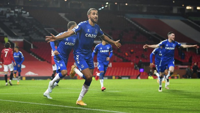 Evertons Dominic Calvert-Lewin, centre, celebrates after scoring his sides third goal during an English Premier League soccer match between Manchester United and Everton at the Old Trafford stadium in Manchester, England, Saturday Feb. 6, 2021. (Michael Regan/Pool via AP)