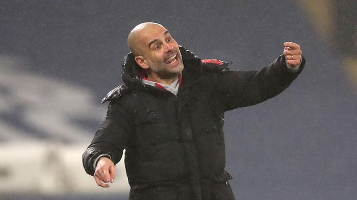 MANCHESTER, ENGLAND - JANUARY 13: Manager of Manchester City, Pep Guardiola gives their team instructions during the Premier League match between Manchester City and Brighton & Hove Albion at Etihad Stadium on January 13, 2021 in Manchester, England. Sporting stadiums around England remain under strict restrictions due to the Coronavirus Pandemic as Government social distancing laws prohibit fans inside venues resulting in games being played behind closed doors. (Photo by Clive Brunskill/Getty Images)