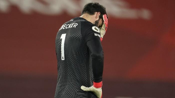Liverpool's goalkeeper Alisson reacts after Manchester City's Raheem Sterling scored his side's third goal during the English Premier League soccer match between Liverpool and Manchester City at Anfield Stadium, Liverpool, England, Sunday, Feb. 7, 2021. (AP photo/Jon Super, Pool)