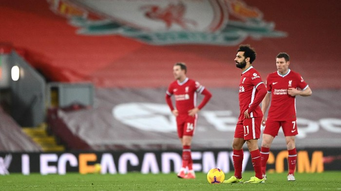 LIVERPOOL, ENGLAND - FEBRUARY 07: Mohamed Salah of Liverpool looks dejected after Manchester Citys fourth goal scored by Raheem Sterling (Not pictured) during the Premier League match between Liverpool and Manchester City at Anfield on February 07, 2021 in Liverpool, England. Sporting stadiums around the UK remain under strict restrictions due to the Coronavirus Pandemic as Government social distancing laws prohibit fans inside venues resulting in games being played behind closed doors. (Photo by Laurence Griffiths/Getty Images)