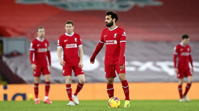 Liverpools Mohamed Salah, center, reacts after Manchester Citys Ilkay Gundogan scored his sides second goal during the English Premier League soccer match between Liverpool and Manchester City at Anfield Stadium, Liverpool, England, Sunday, Feb. 7, 2021. (Laurence Griffiths/Pool via AP)