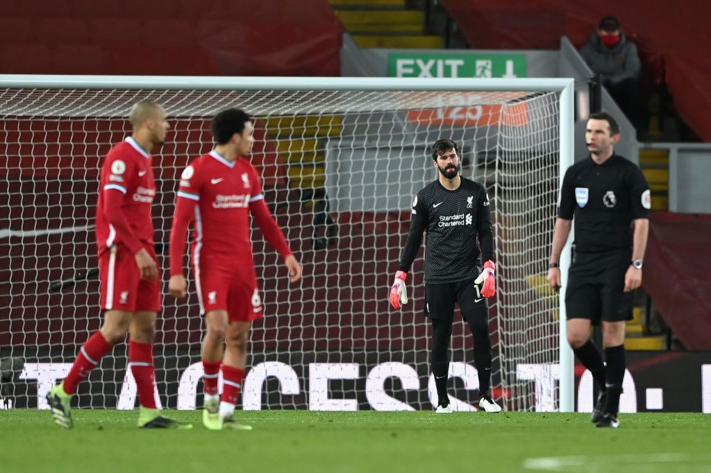 LIVERPOOL, ENGLAND - FEBRUARY 07: Alisson Becker of Liverpool looks dejected after Liverpool's third goal scored by Raheem Sterling (Not pictured) of Manchester City during the Premier League match between Liverpool and Manchester City at Anfield on February 07, 2021 in Liverpool, England. Sporting stadiums around the UK remain under strict restrictions due to the Coronavirus Pandemic as Government social distancing laws prohibit fans inside venues resulting in games being played behind closed doors. (Photo by Laurence Griffiths/Getty Images)