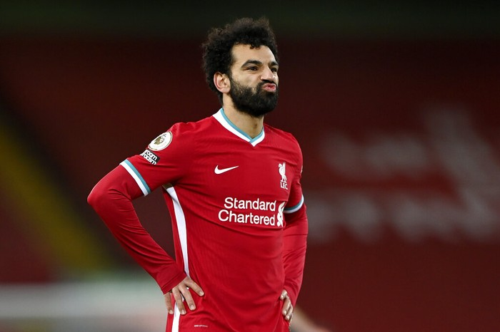 Liverpools Mohamed Salah reacts after Manchester Citys Phil Foden scored his sides fourth goal during the English Premier League soccer match between Liverpool and Manchester City at Anfield Stadium, Liverpool, England, Sunday, Feb. 7, 2021. (Laurence Griffiths/Pool via AP)