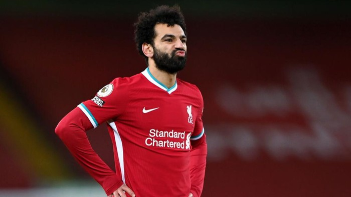 LIVERPOOL, ENGLAND - FEBRUARY 07: Mohamed Salah of Liverpool shows his frustration during the Premier League match between Liverpool and Manchester City at Anfield on February 07, 2021 in Liverpool, England. Sporting stadiums around the UK remain under strict restrictions due to the Coronavirus Pandemic as Government social distancing laws prohibit fans inside venues resulting in games being played behind closed doors. (Photo by Laurence Griffiths/Getty Images)