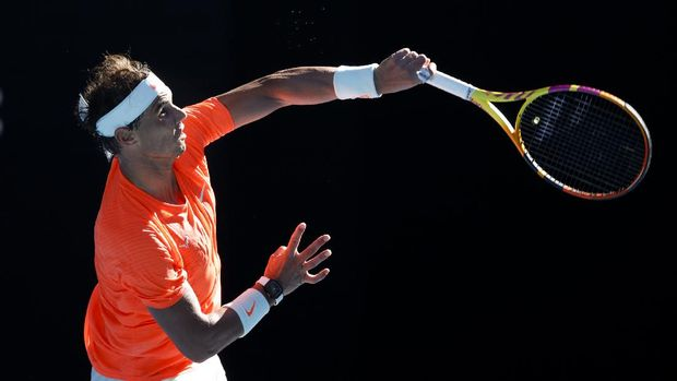 Spain's Rafael Nadal serves to Serbia's Laslo Djere during their first round match at the Australian Open tennis championship in Melbourne, Australia, Tuesday, Feb. 9, 2021.(AP Photo/Rick Rycroft)