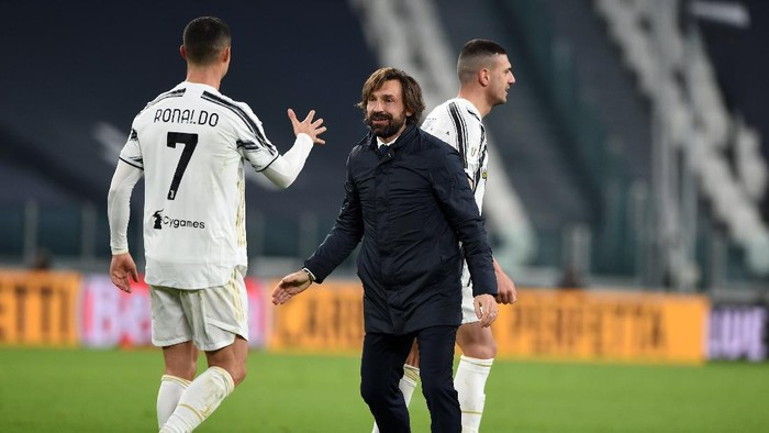 TURIN, ITALY - FEBRUARY 09: Andrea Pirlo, Head coach of Juventus celebrates with Cristiano Ronaldo of Juventus following the Coppa Italia semi-final Juventus and FC Internazionale at Allianz Stadium on February 09, 2021 in Turin, Italy. Sporting stadiums around Italy remain under strict restrictions due to the Coronavirus Pandemic as Government social distancing laws prohibit fans inside venues resulting in games being played behind closed doors. (Photo by Chris Ricco/Getty Images)