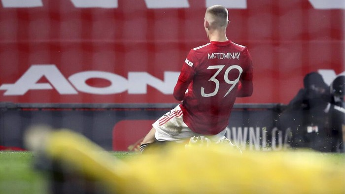 Manchester Uniteds Scott McTominay celebrates after scoring his sides first goal during the English FA Cup 5th round soccer match between Manchester United and West Ham United at Old Trafford in Manchester, England, Tuesday, Feb. 9, 2021. (Martin Rickett/Pool via AP)