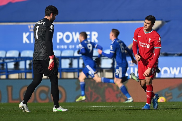 LEICESTER, ENGLAND - FEBRUARY 13: Alisson of Liverpool speaks with Ozan Kabak of Liverpool after they concede a second goal during the Premier League match between Leicester City and Liverpool at The King Power Stadium on February 13, 2021 in Leicester, England. Sporting stadiums around the UK remain under strict restrictions due to the Coronavirus Pandemic as Government social distancing laws prohibit fans inside venues resulting in games being played behind closed doors. (Photo by Michael Regan/Getty Images)