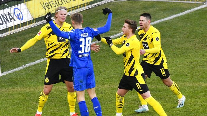 Hoffenheims Stefan Posch argues with Dortmunds Erling Haaland, left, during the German Bundesliga soccer match between Borussia Dortmund and TSG 1899 Hoffenheim in Dortmund, Germany, Saturday, Feb. 13, 2021. (AP Photo/Martin Meissner, Pool)
