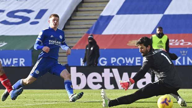 Leicester's Harvey Barnes, left, scores his side's third goal during the English Premier League soccer match between Leicester City and Liverpool at the King Power Stadium in Leicester, England, Saturday, Feb. 13, 2021. (Paul Ellis/Pool Photo via AP)
