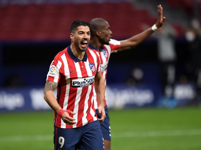 MADRID, SPAIN - FEBRUARY 08: Luis Suarez of Atletico de Madrid celebrates after scoring their teams second goal during the La Liga Santander match between Atletico de Madrid and RC Celta at Estadio Wanda Metropolitano on February 08, 2021 in Madrid, Spain. Sporting stadiums around Spain remain under strict restrictions due to the Coronavirus Pandemic as Government social distancing laws prohibit fans inside venues resulting in games being played behind closed doors.  (Photo by Denis Doyle/Getty Images)