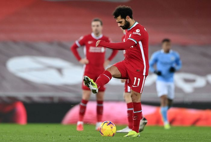 LIVERPOOL, ENGLAND - FEBRUARY 07: Mohamed Salah of Liverpool looks dejected after Manchester Citys third goal scored by Raheem Sterling (Not pictured) during the Premier League match between Liverpool and Manchester City at Anfield on February 07, 2021 in Liverpool, England. Sporting stadiums around the UK remain under strict restrictions due to the Coronavirus Pandemic as Government social distancing laws prohibit fans inside venues resulting in games being played behind closed doors. (Photo by Laurence Griffiths/Getty Images)