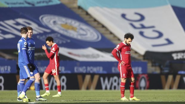 Liverpool's Mohamed Salah, right, reacts after Leicester's James Maddison scores his side's opening goal during the English Premier League soccer match between Leicester City and Liverpool at the King Power Stadium in Leicester, England, Saturday, Feb. 13, 2021. (Carl Recine/Pool Photo via AP)