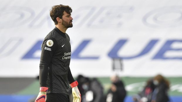 Liverpool's goalkeeper Alisson reacts after the final whistle end of the English Premier League soccer match between Leicester City and Liverpool at the King Power Stadium in Leicester, England, Saturday, Feb. 13, 2021. (Paul Ellis/Pool Photo via AP)