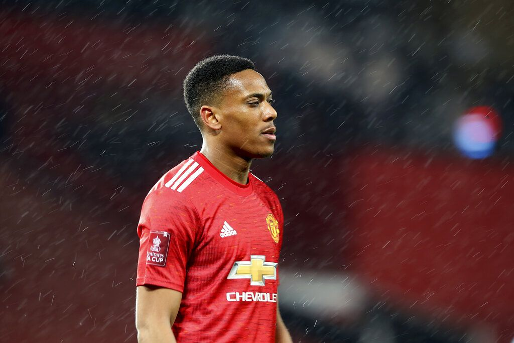 Manchester United's Anthony Martial walks on the pitch during the English FA Cup 5th round soccer match between Manchester United and West Ham United at Old Trafford in Manchester, England, Tuesday, Feb. 9, 2021. (Martin Rickett/Pool via AP)