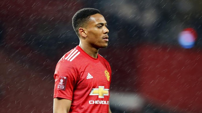 Manchester Uniteds Anthony Martial walks on the pitch during the English FA Cup 5th round soccer match between Manchester United and West Ham United at Old Trafford in Manchester, England, Tuesday, Feb. 9, 2021. (Martin Rickett/Pool via AP)