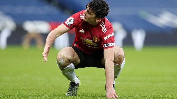 WEST BROMWICH, ENGLAND - FEBRUARY 14: Harry Maguire of Manchester United reacts at the full time whistle during the Premier League match between West Bromwich Albion and Manchester United at The Hawthorns on February 14, 2021 in West Bromwich, England. Sporting stadiums around the UK remain under strict restrictions due to the Coronavirus Pandemic as Government social distancing laws prohibit fans inside venues resulting in games being played behind closed doors. (Photo by Naomi Baker/Getty Images)