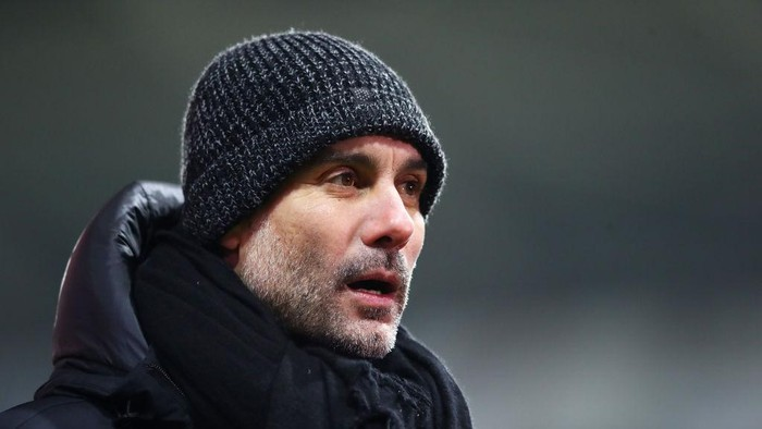 SWANSEA, WALES - FEBRUARY 10: Pep Guardiola, Manager of Manchester City reacts during The Emirates FA Cup Fifth Round match between Swansea City and Manchester City at Liberty Stadium on February 10, 2021 in Swansea, Wales. Sporting stadiums around the UK remain under strict restrictions due to the Coronavirus Pandemic as Government social distancing laws prohibit fans inside venues resulting in games being played behind closed doors. (Photo by Michael Steele/Getty Images)