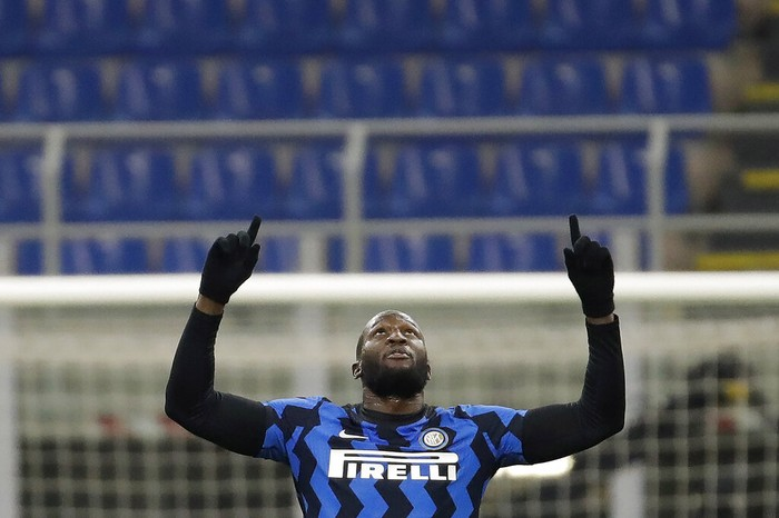 Inter Milans Romelu Lukaku celebrates after scores his second goal against Lazio during a Serie A soccer match between Inter Milan and Lazio at the San Siro stadium in Milan, Italy, Sunday, Feb. 14, 2021. (AP Photo/Luca Bruno)