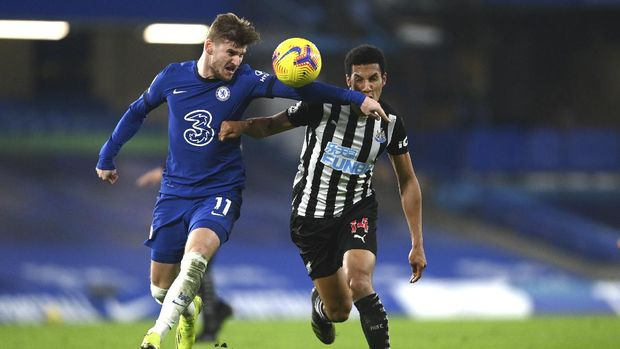 Chelsea's Timo Werner, left, and Newcastle's Isaac Hayden challenge for the ball during the English Premier League soccer match between Chelsea and Newcastle United at Stamford Bridge Stadium in London, England, Monday, Feb. 15, 2021. (Mike Hewitt /Pool via AP)