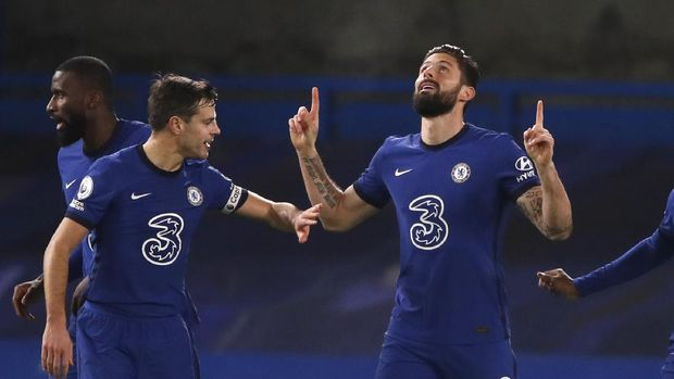 Chelsea's Olivier Giroud celebrates after scoring his side's opening goal during the English Premier League soccer match between Chelsea and Newcastle United at Stamford Bridge Stadium in London, England, Monday, Feb. 15, 2021. (Paul Childs/Pool via AP)