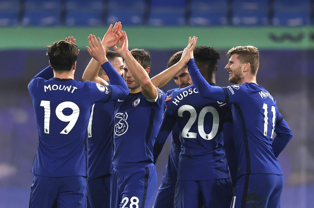 Chelsea's Timo Werner, right, celebrates with teammates after scoring his side's second goal during the English Premier League soccer match between Chelsea and Newcastle United at Stamford Bridge Stadium in London, England, Monday, Feb. 15, 2021. (Adrian Dennis/Pool via AP)