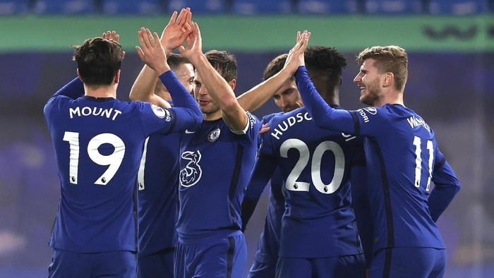 Chelseas Timo Werner, right, celebrates with teammates after scoring his sides second goal during the English Premier League soccer match between Chelsea and Newcastle United at Stamford Bridge Stadium in London, England, Monday, Feb. 15, 2021. (Adrian Dennis/Pool via AP)