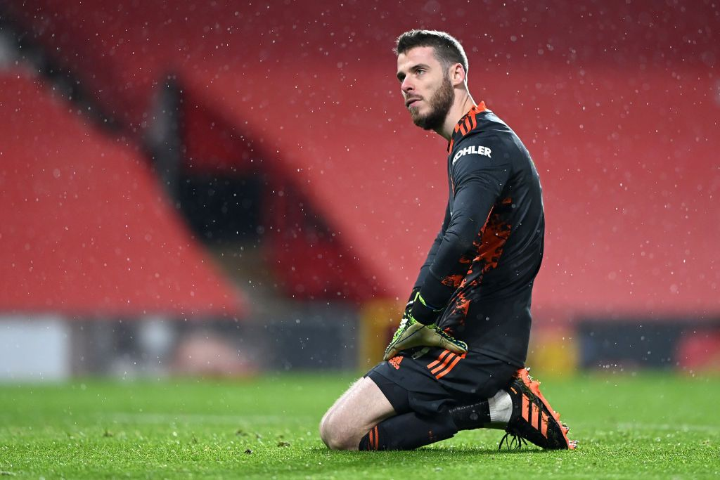 MANCHESTER, ENGLAND - JANUARY 27: David De Gea of Manchester United reacts after Sheffield United score their second goal during the Premier League match between Manchester United and Sheffield United at Old Trafford on January 27, 2021 in Manchester, England. Sporting stadiums around the UK remain under strict restrictions due to the Coronavirus Pandemic as Government social distancing laws prohibit fans inside venues resulting in games being played behind closed doors. (Photo by Laurence Griffiths/Getty Images)