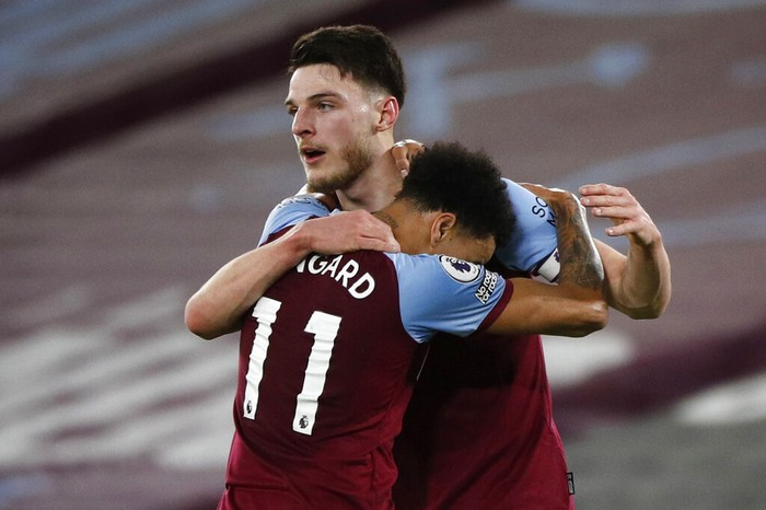 West Hams Declan Rice, rear, celebrates with Jesse Lindgard after scoring the opening goal during an English Premier League soccer match between West Ham and Sheffield United at the London stadium in London, England, Monday Feb. 15, 2021. (John Sibley/Pool via AP)