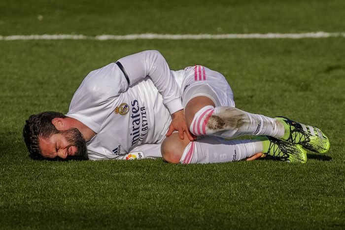 Real Madrids Nacho grimaces in pain during the Spanish La Liga soccer match between Real Madrid and Valencia at the Alfredo Di Stefano stadium in Madrid, Spain, Sunday, Feb. 14, 2021. (AP Photo/Manu Fernandez)