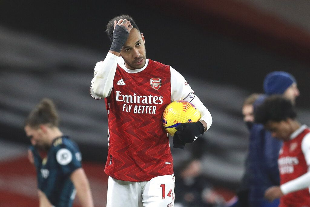 Arsenal's Pierre-Emerick Aubameyang walks off with the match ball after the English Premier League soccer match between Arsenal and Leeds United at the Emirates stadium in London, England, Sunday, Feb. 14, 2021. (Adam Davy/Pool via AP)