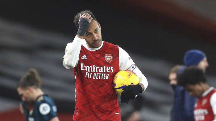 Arsenals Pierre-Emerick Aubameyang walks off with the match ball after the English Premier League soccer match between Arsenal and Leeds United at the Emirates stadium in London, England, Sunday, Feb. 14, 2021. (Adam Davy/Pool via AP)
