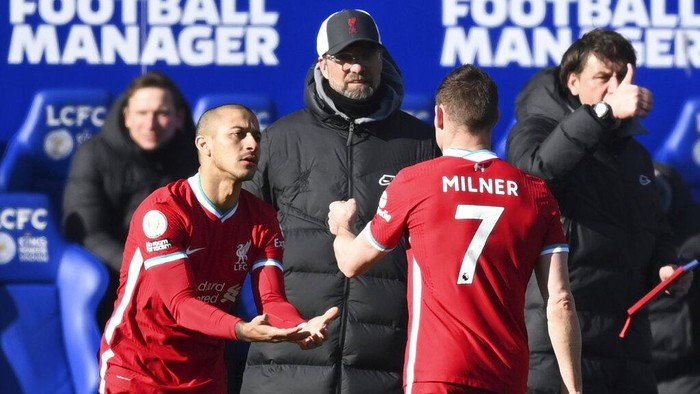 Liverpools James Milner, right, is substituted by Liverpools Thiago during the English Premier League soccer match between Leicester City and Liverpool at the King Power Stadium in Leicester, England, Saturday, Feb. 13, 2021. (Michael Regan/Pool Photo via AP)