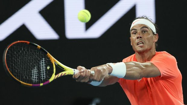 Spain's Rafael Nadal hits a backhand return to Greece's Stefanos Tsitsipas during their quarterfinal match at the Australian Open tennis championship in Melbourne, Australia, Wednesday, Feb. 17, 2021.(AP Photo/Hamish Blair)