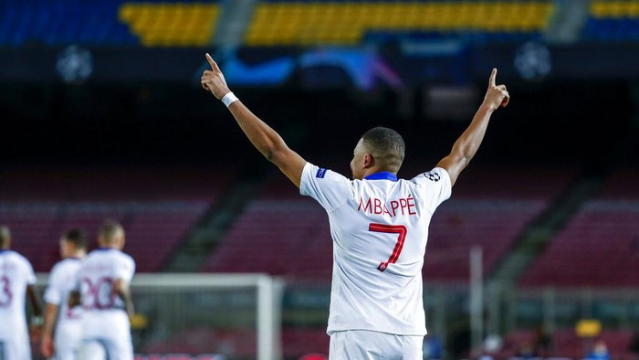 PSGs Kylian Mbappe celebrates after scoring during the Champions League round of 16, first leg soccer match between FC Barcelona and Paris Saint-Germain at the Camp Nou stadium in Barcelona, Spain, Tuesday, Feb. 16, 2021. (AP Photo/Joan Monfort)